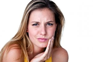 young woman with nagging toothache