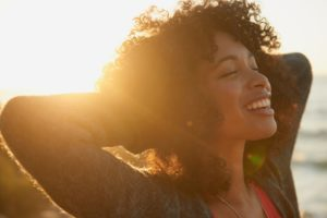 woman smiling in the sunset